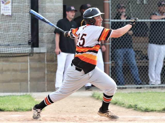 Brody Williams collects a first-inning single for the Trojans in the team's sectional win over Mechanicsburg.