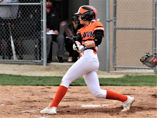 Paige Burrell drills a home run for the Arcanum in the Lady Trojans in win over Covington.