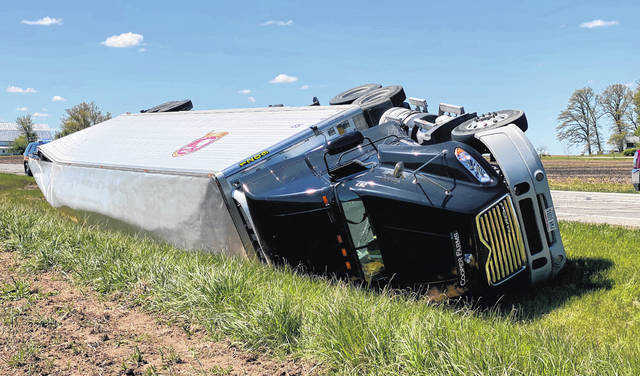A semi-tractor trailer lays on its side following a rollover accident Wednesday morning on U.S. Route 127. Traffic was closed for several hours.