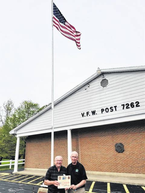 The Greenville VFW Post 7262 is currently flying an American flag that once flew over Iraq during combat in 2004. Pictured is VFW post quarter master Don Dietrich with Gaylen Blosser, life VFW member and commissioner with Darke County Veteran Services.