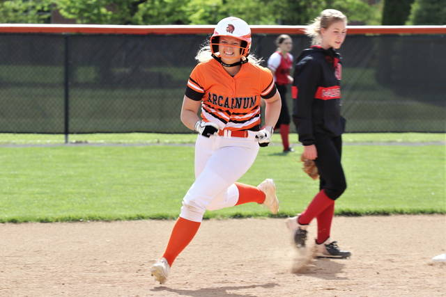 Ellie Fout rounds second after hitting a home run in five consecutive Arcanum Lady Trojans varsity softball games.