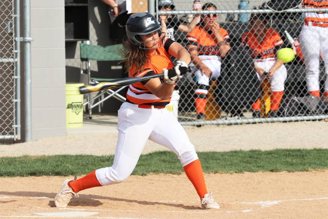 Arcanum freshman shortstop, Emilie Fout goes 3-4 in the Lady Trojans 11-0 win over National Trail.