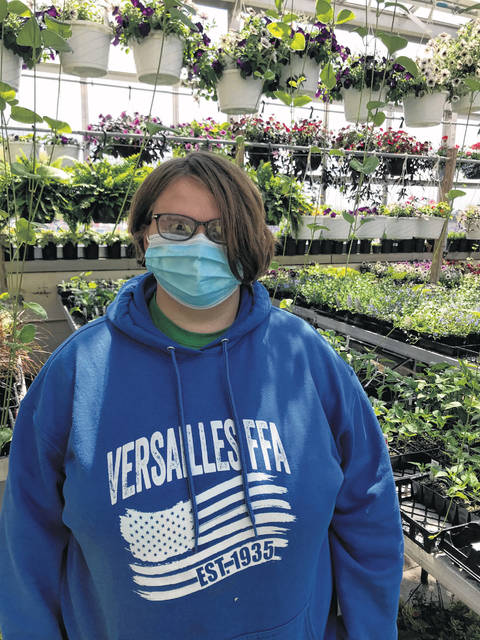 The Versailles Agricultural Education department and FFA chapter is conducting its 10th annual greenhouse sale. Pictured is Versailles FFA member and Greenhouse Manager Lucy Petitjean.