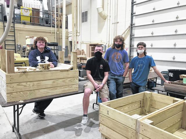Versailles FFA students delivered four raised garden boxes to the Versailles Healthcare Center in conjunction with the virtual State FFA Convention on April 29. Pictured are Mechanical Principle students from left to right: Elliot George, Jacob Garrison, Dawson Petitjean and Xavier Grillot standing beside the raised garden beds they built.