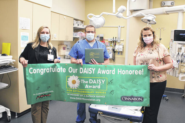 Registered nurse Lonnie Campbell was awarded the spring 2021 DAISY Award. From left to right is Chief Nursing Officer Kim Freeman, Campbell, and Director of Emergency Services Lindsey Terrace.