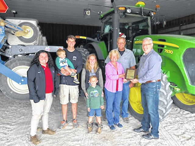 The Overholser family was recognized by the Ohio State University Extension for their support of county and statewide Extension programming. Pictured from left to right is Taylor Dill, Aaron Overholser, Banks Overholser, Lindsey Overholser, Brody Overholser, Peggy Overholser, Bo Overholser and Sam Custer.
