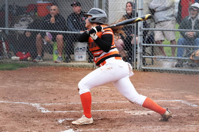 Arcanum freshman shortstop Emilie Fout drills a 2-run homer in the Lady Trojans Sectional Championship win over Indian Lake.