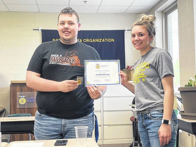 Shown are, left, Justin Bryan, Member of the Month, and right, Alexis Barhorst, Chapter President. The May SAE Spotlight is sophomore Isabella Hamilton (not shown).