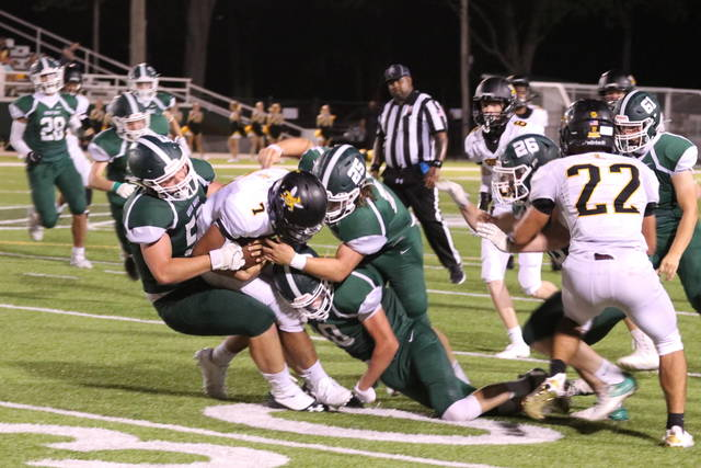 Greenville Green Wave football gets a team tackle in the 2020 OHSAA football season.