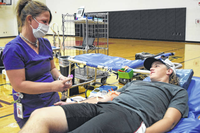 MVHS sophomore and FFA member Aron Hunt made his first lifetime donation at the Grudge Match.