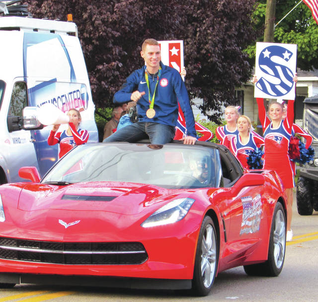 Tri-Village's Clayton Murphy (shown in a 2016 parade in New Madison) will be returning to compete in the 2021 Olympics in Tokyo after winning the 800-meter Olympic time trials.