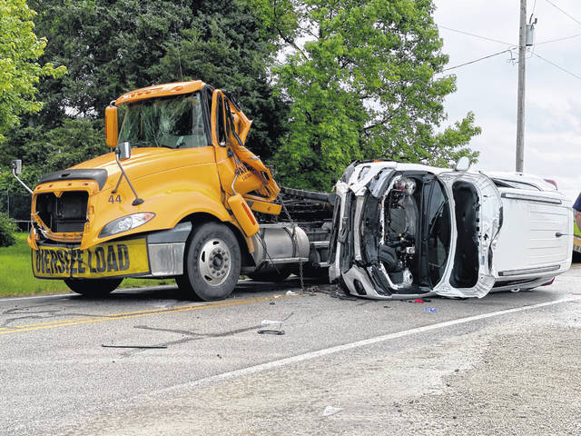 A Chevy SUV went airborn Monday morning near Greenville, crashing into the cab of a semi-truck and flatbead trailer. The driver was reportedly treated for non-life-threatening injuries.