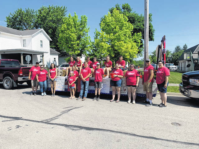 Versailles FFA had a float in the 2021 Versailles Poultry Day's Parade. A special thank you to the following Versailles FFA members and alumni for participating in the parade (left to right, front row): Versailles FFA Alumni Curt Goubeaux, Versailles FFA advisor Taylor Bergman, Versailles FFA members Dakota Overholser, Emma Middendorf, Isisah Hess, Blake Schmitmeyer, Laura Wuebker, Lucy Petitjean, Versailles FFA Alumni member Dallas Hess and Versailles FFA Advisor Dena Wuebker and in front Lydia Goubeaux. Back row, left to right: Versailles FFA members Zoe Billenstein,Lexie DeMange, Greg Dircksen, Griffon Miller, Elise George and Alex Dircksen.