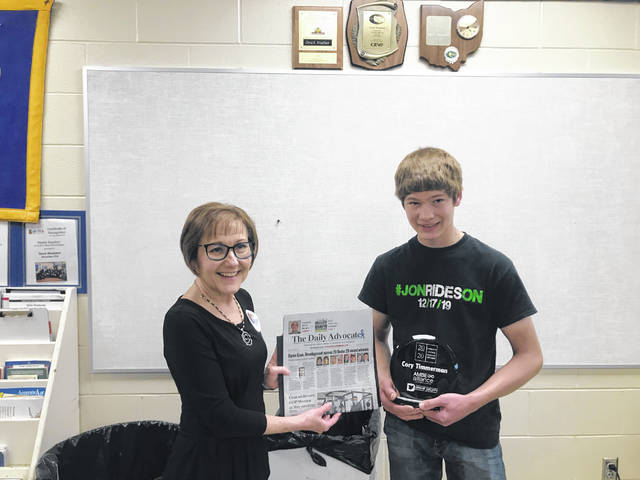 Versailles junior Cory Timmerman accepted his Top 20 Under 20 Award from Tamala Marley, Workforce Specialist with Darke County Economic Development.