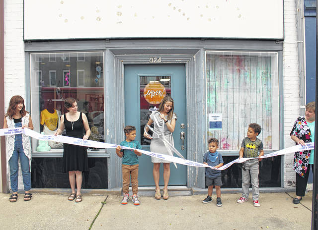 The Gracious Mineral Company held its grand reopening Friday morning with a ribbon cutting at the new store located at 324 S. Broadway Street. Pictured are (left to right) store employee Betty Sanders, store employee Taylor Denniston, business owner Destiny Phlipot and her children, and Darke County Chamber of Commerce President Peggy Emerson.