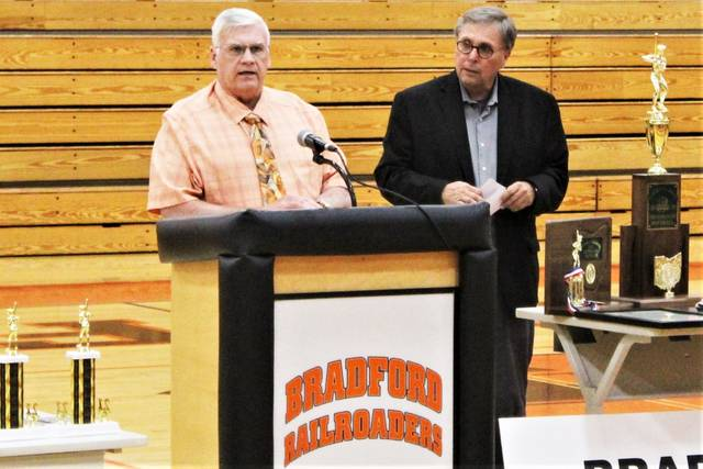 Darke County Commissioners Mike Stegall and Larry Holmes present the Bradford Lady Railroaders with a Proclomation. (L-R) Mike Stegall and Larry Holmes.