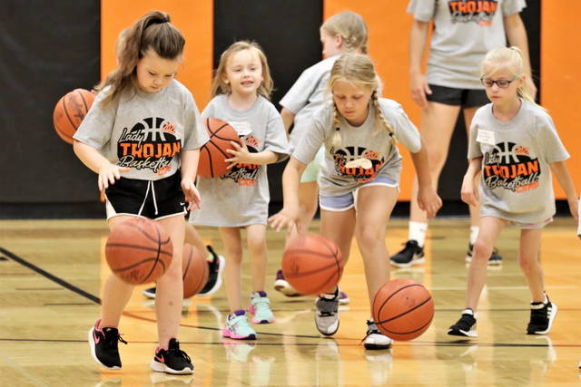 Lady Trojans basketball campers work on dribbling skills at the Arcanum camp.