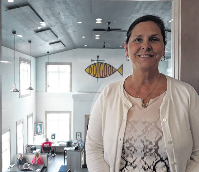 Karen Homan (pictured), founder of the Do Good Restaurant and Ministry, located at 25 West Main Street in Osgood, stands by the second floor window which overlooks the activities below.