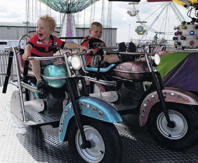Eli Carter (left), age 2, and his brother, Jackson Carter (3) were ready to ride at the Radiant H.O.P.E. Fun Fest hosted by the Radiant Lighthouse, located at 5256 Sebring Warner Road, Greenville.