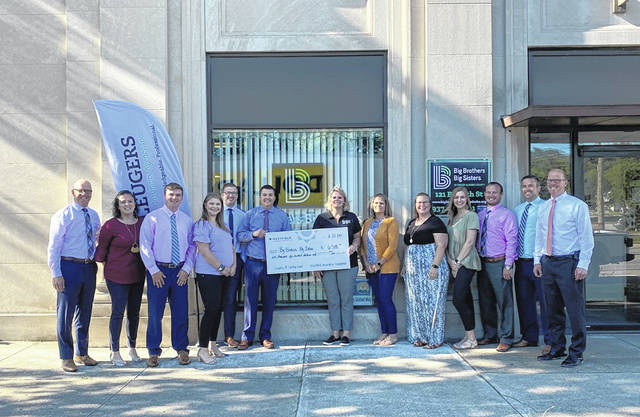 Leugers Insurance Agency nominated Big Brother Big Sisters of Shelby & Darke Counties to receive a $6,500 donation as part of Westfield's Legacy of Caring program. Presenting the check are, left to right, Brian Seitz, Vicki Link, Ethan Burd, Morgan Albers, Troy Prenger, Mark Heitman, all from Leugers Insurance, Jennifer Bruns, executive director of Big Brothers Big Sister of Shelby & Darke Counties, Jacque Leverette, Keshia Willmann, Sarah Bey, Scott Holthaus, Tony Schwieterman and Brad Seitz, all of Leugers Insurance.