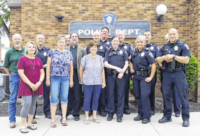 Members of St. Paul's Lutheran Church stand together with members of the Greenville City Police Department, honoring each officer with a letter of appreciation and gift cards to area businesses. Pictured are: Pastor Alan Knoke, Mike Meckes, Shelley Meckes, Virginia Kagey, Pam Clum, Sgt. Flanery, PO Dickmann, PO Spradley, Chief Eric Roberts, Lt. Scot Ross, PO Manson, PO Mercado, Lt. Benge, Det. Reed, and PO Jones.