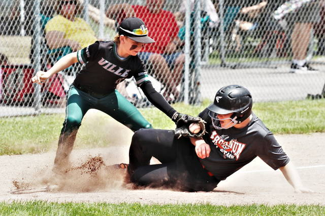 A Greenville third baseman makes a tag on a sliding an Arcanum player in the Tyler Kuhn Memorial Tournament.