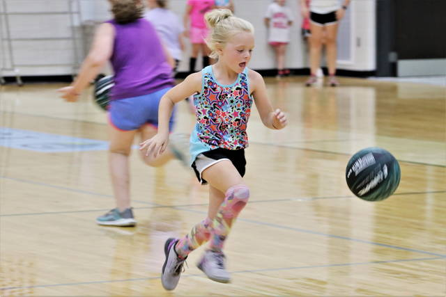 A young camper hustles down the court at the Greenville girls basketball camp.