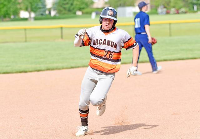 The Trojans Carter Rhodehamel collects a hit in the team's district finals matchup.