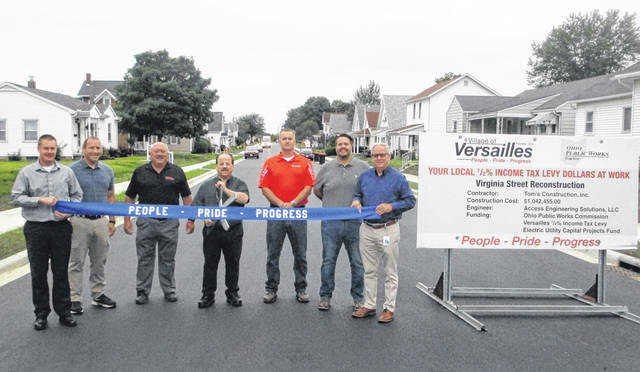 On site to commemorate the completion of the Virginia Street Project are Councilman Jeff Beasley, Councilman Lance Steinbrunner, Village Administrator Mike Busse, Mayor Jeff Subler, Asst. Village Administrator Kyle Francis, Councilman Cory Griesdorn, and Councilman Todd Dammeyer.