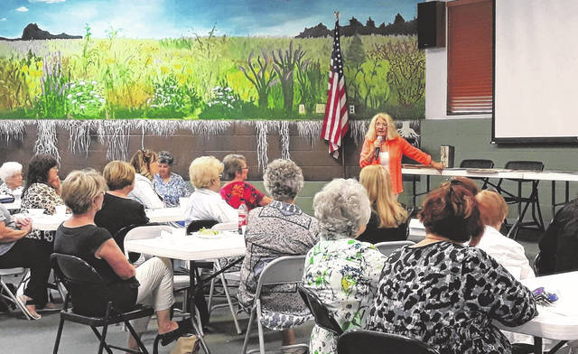 Cindy Pike, Darke County's Clerk of Courts of the Common Pleas, addresses the audience at the Darke County Republican Women's Club meeting July 12. Pike, who has served in public office for over 25 years, has established one-stop vehicle services, to combine vehicle titling, registration and exams at one location. The next DCRWC meeting is Mon., Aug 9.