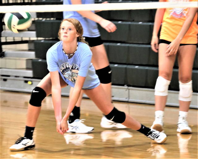 A Lady Wave volleyball camper makes a dig a the team's high school volleyball team camp.