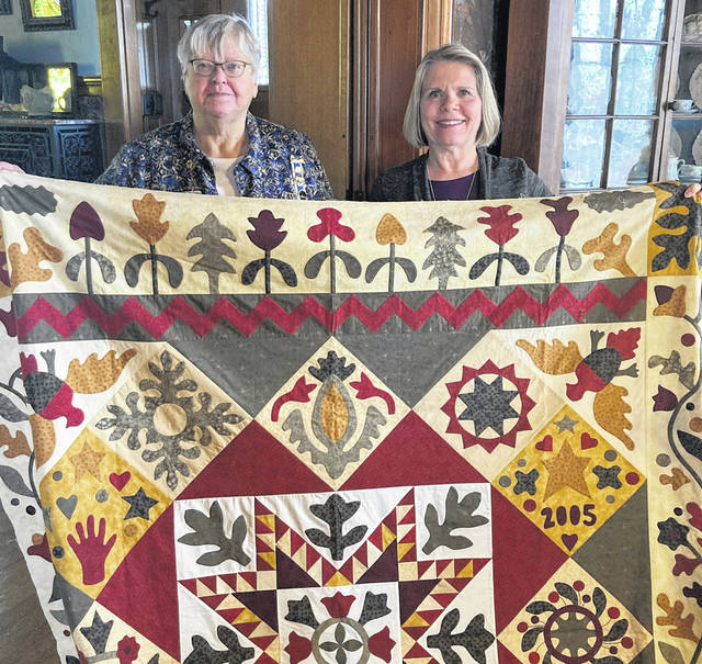 Fort GreeneVille Chapter DAR Regent Brenda Arnett and Virginia Kagey hold up the hand-quilted design which won 1st place at the Ohio DAR State Conference.