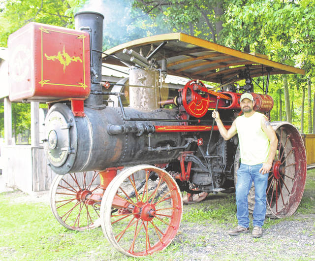 Larry Simmons with his 110-year-old Robinson engine.