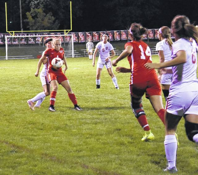 <strong>Ashley Ruble tries to settle the ball with a Tippecanoe defender on her back.</strong>