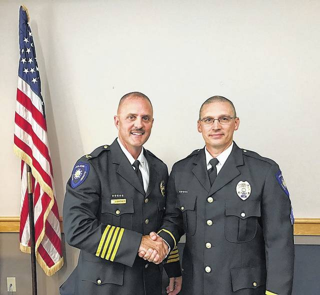 Huber Heights Police Chief Mark Lightner (left) congratulates Sergeant Brad Reaman on his recent promotion.