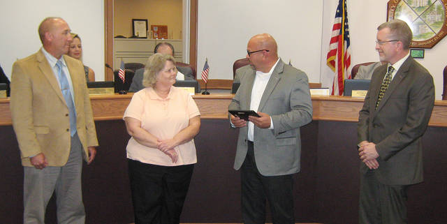LuAnn Miller was named the Huber Heights employee of the second quarter. She is pictured receiving her award from Mayor Tom McMasters, City Manager Rob Schommer and Director of Finance Jim Bell.
