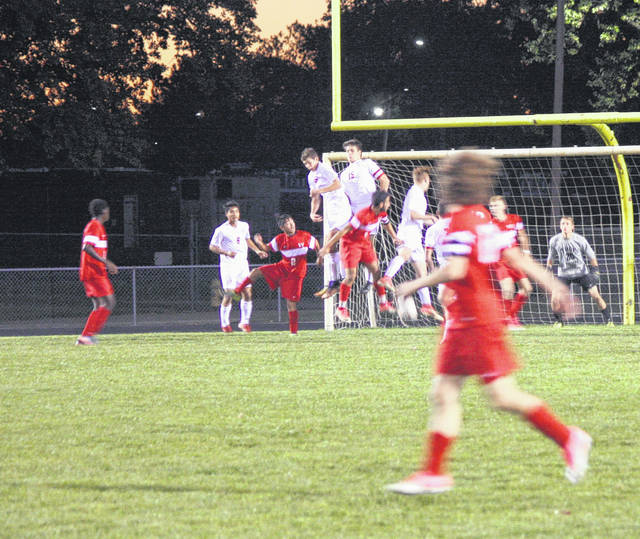 <strong>Brandon Burkey sends a direct kick towards the goal. Trying to score are Ntae Johnson and Justin Doan. Defending is (15) Joey Sheehan, (6) Jon Hipolito, (4) Alex Bridge and keeper Nicholas Griswold.</strong>