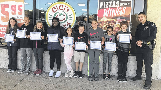 Pictured, left to right, are the Huber Heighgs City Schools Safety Patrol of the Month for October: Valery Cooper and Evan Sullenberger from Charles H. Huber, Kennedy Reeser and Desiree Chappell from Wright Brothers, Britani Sanders and Will Ganion from Monticello, Darren Bailey and Bailey Bowman from Rushmore, Gavin Murray from Valley Forge Elementary, and Officer Lambert from the Huber Heights Police Division.