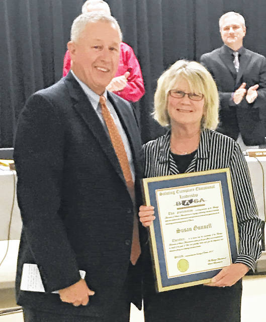 Dr. Kirk Hamilton, Executive Director of Buckeye Association of School Administrators, presented the association's Exemplary Leadership Award to Huber Heights City Schools Superintendent Susan Gunnell.