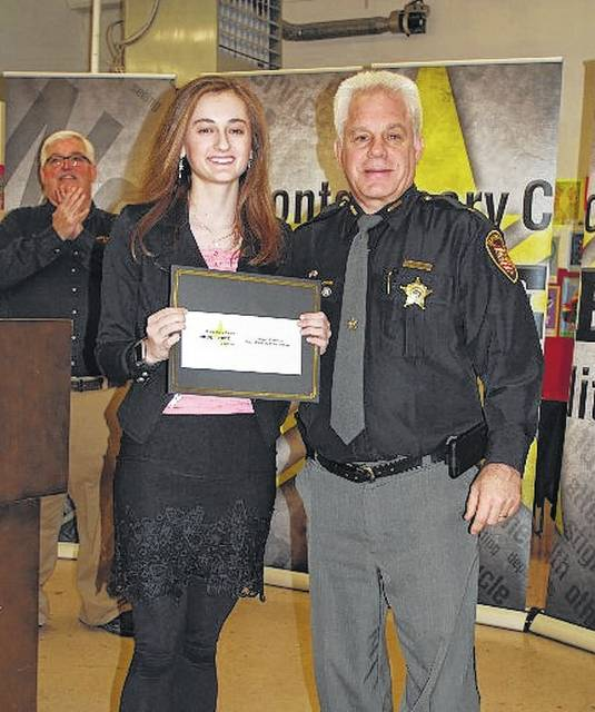 Wayne High School student Abigail Kerestes was the overall winner of the 2017 Montgomery County Drug-Free Coalition Poster and Poetry Contest. She is pictured with Montgomery County Sheriff Phil Plummer.