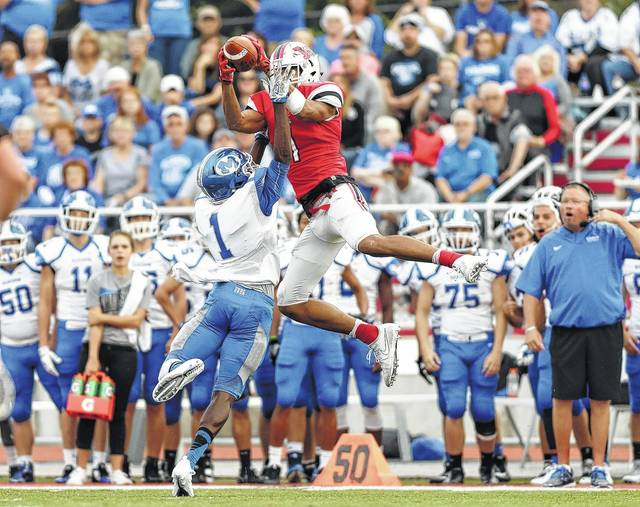 <strong>L'Christian Smith flies high for a reception against Miamisburg. Smith was named First Team Offense on the Division I All-Ohio football team by the Ohio Prep Sportswriters Association.</strong>