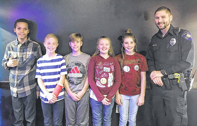 Pictured from left to right-Garret Gray-Charles Huber Elementary, Kannon Reeser-Wright Brothers Elementary, Josh Hedges-Wright Brothers Elementary, Brianna Williams-Rushmore Elementary, Abbie Dodge-Rushmore Elementary, and Officer Lambert-Huber Heights Police Division. Not pictured is Dakota Pirrung.