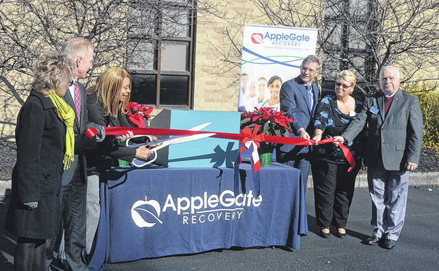 Staff at Applegate Recovery cut a grand-opening ribbon on their opioid treatment facility on Brandt Pike in Huber Heights last Friday.