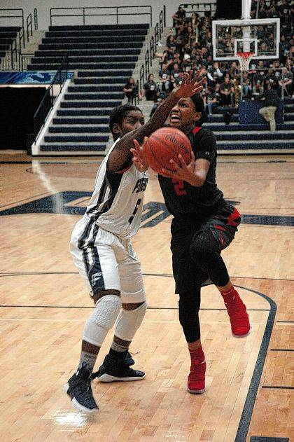 <strong>Nyla Hampton fights her way past Kierra Thornton to score during the first half at Fairmont.</strong>