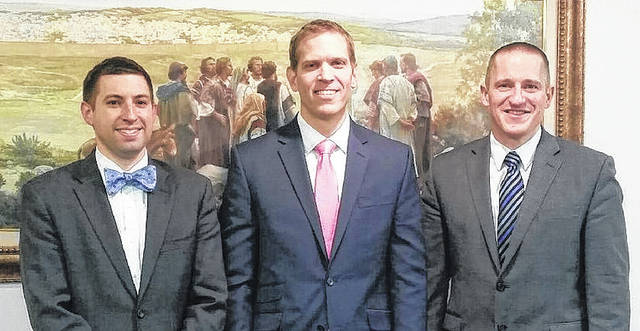 Taylor Smith of Huber Heights has been named the new bishop of the Huber Heights Ward of The Church of Jesus Christ of Latter-day Saints. He is pictured with counselors are Jonathon Climer (left) and Cameron Coon (right).