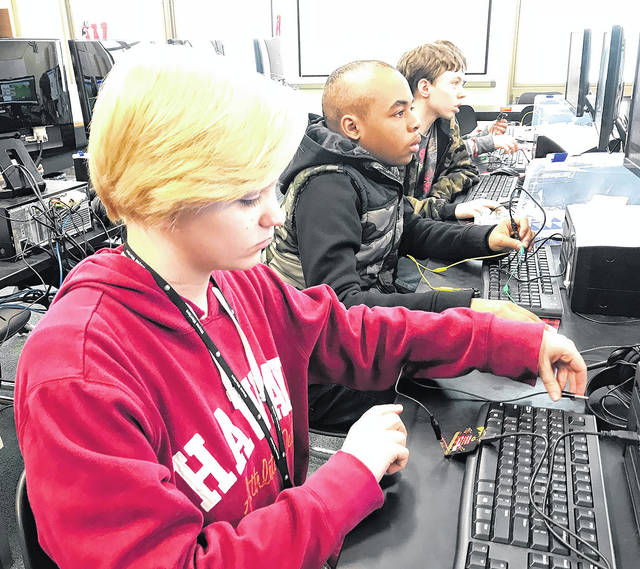Allison Arnett and other students work on a problem as part of Weisenborn Junior High School's nationally recognized STEM and career learning program.
