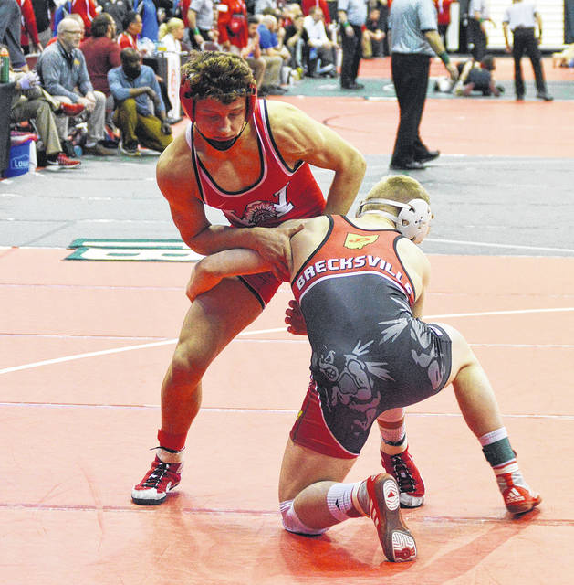 <strong>Austin Mullins battles Victor Voinovich of Brecksville Broadview Heights in the championship preliminary round of the state tournament. In the battle between the two standout freshmen Voinovich emerged with a 7-1 victory.</strong>