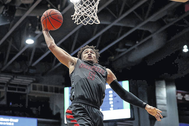 "<strong>L'Christian ""Blue"" Smith goes up for a dunk against Oak Hills in the district final Saturday at U.D. Arena. Smith led the Warriors with 23 points.</strong>"