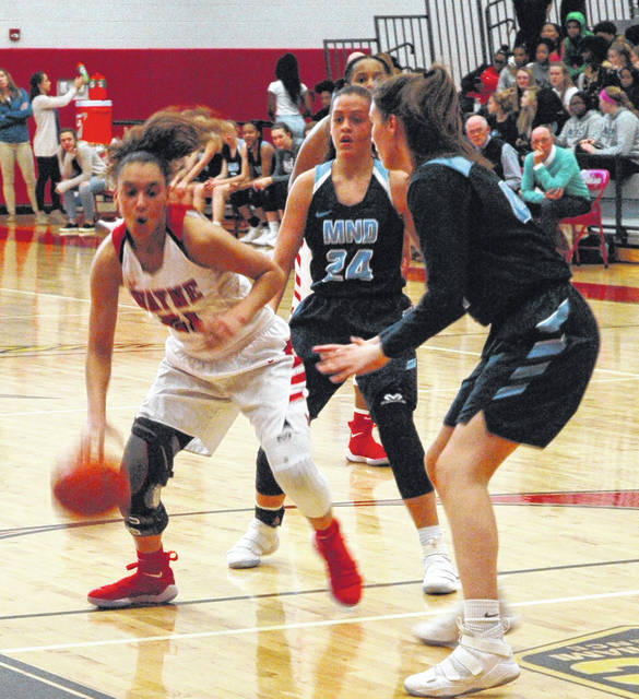 <strong>Destiny Bohanon drives into the paint as Gabbie Marshall (24) and Grace Centrulla defend.</strong>