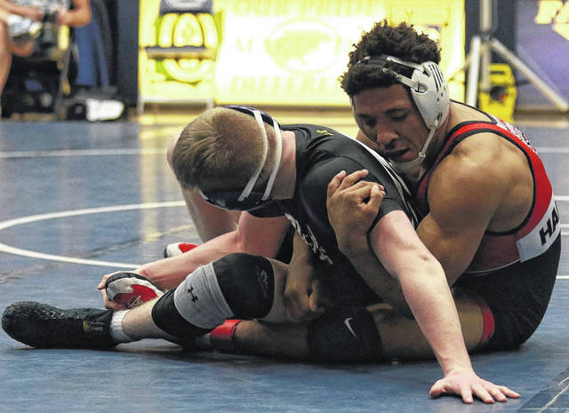 <strong>Jordan Hardrick scored a solid 5-1 decision over Jestin Love of Butler in the district final to capture the 152 pound title.</strong>